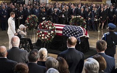 Roberta McCain, the 106-year-old mother of Sen. John McCain, R-Ariz., pays her respects to the flag-draped casket bearing the remains of her son, Friday, Aug. 31, 2018 in the US Capitol in Washington. (Jim Watson/Pool photo via AP)