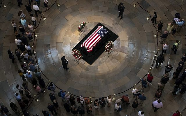Members of the public walk past the flag-draped casket bearing the remains of John McCain of Arizona, who lived and worked in Congress over four decades, in the US Capitol rotunda in Washington, Friday, Aug. 31, 2018. (AP/J. Scott Applewhite)