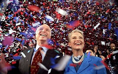 In this Jan. 30, 2000 file photo, Republican presidential hopeful, Sen. John McCain, R-Ariz., and his wife Cindy, smile as confetti falls on them at the end of their 114th New Hampshire town hall meeting with voters at the Peterborough Town House in Peterborough, N.H. (AP/Stephan Savoia)