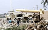 Illustrative: Children play near an abandoned Iraqi Scud missile mounted on a mobile launcher along the Tigris River on the outskirts of Baghdad, Iraq Wednesday, June 4, 2003. (AP Photo/Bullit Marquez)