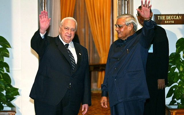 Israeli Prime Minister Ariel Sharon, left, and Indian Prime Minister Atal Bihari Vajpayee wave to the media before talks in New Delhi, India, Tuesday, Sept. 9, 2003. (AP Photo/Manish Swarup)