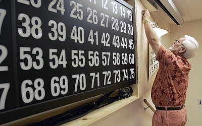 Illustrative: Bingo Chairman Mike Muldoon removes old instructions from a game board at the Elks Lodge in Hot Springs, Ark., on July 27, 2007. (AP Photo/Danny Johnston)