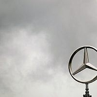 Dark clouds surround the Mercedes emblem on the roof of the headquarters of the Daimler AG in Stuttgart, Germany, on April 28, 2009. (AP Photo/Daniel Maurer)