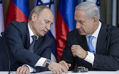Russian President Vladimir Putin speaks with Prime Minister Benjamin Netanyahu as they prepare to deliver joint statements after a meeting and a lunch in the Israeli leader's Jerusalem residence, Monday, June 25, 2012. (AP Photo/Jim Hollander, Pool)