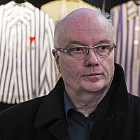 Volkhard Knigge, foundation director of the Nazi concentration camp Buchenwald memorial place, stands in front of vitrines with concentration camp inmates' uniforms near Weimar, central Germany, April 13, 2016. (AP Photo/Jens Meyer)