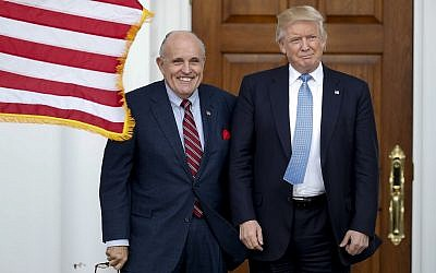 Donald Trump, right, and Rudy Giuliani pose for photographs as Giuliani arrives at the Trump National Golf Club Bedminster clubhouse on Sunday, November 20, 2016, in Bedminster, N.J.. (AP/Carolyn Kaster)