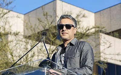 "Reza Aslan speaks at the UTA ""United Voices"" Rally at United Talent Agency headquarters on, February 24, 2017, in Beverly Hills, Calif. (Willy Sanjuan/Invision/AP)"