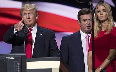 In this photo from July 21, 2016, then-Trump campaign manager Paul Manafort stands between the then-Republican presidential candidate Donald Trump and his daughter Ivanka Trump at the Republican National Convention in Cleveland, Ohio. (AP Photo/Evan Vucci)