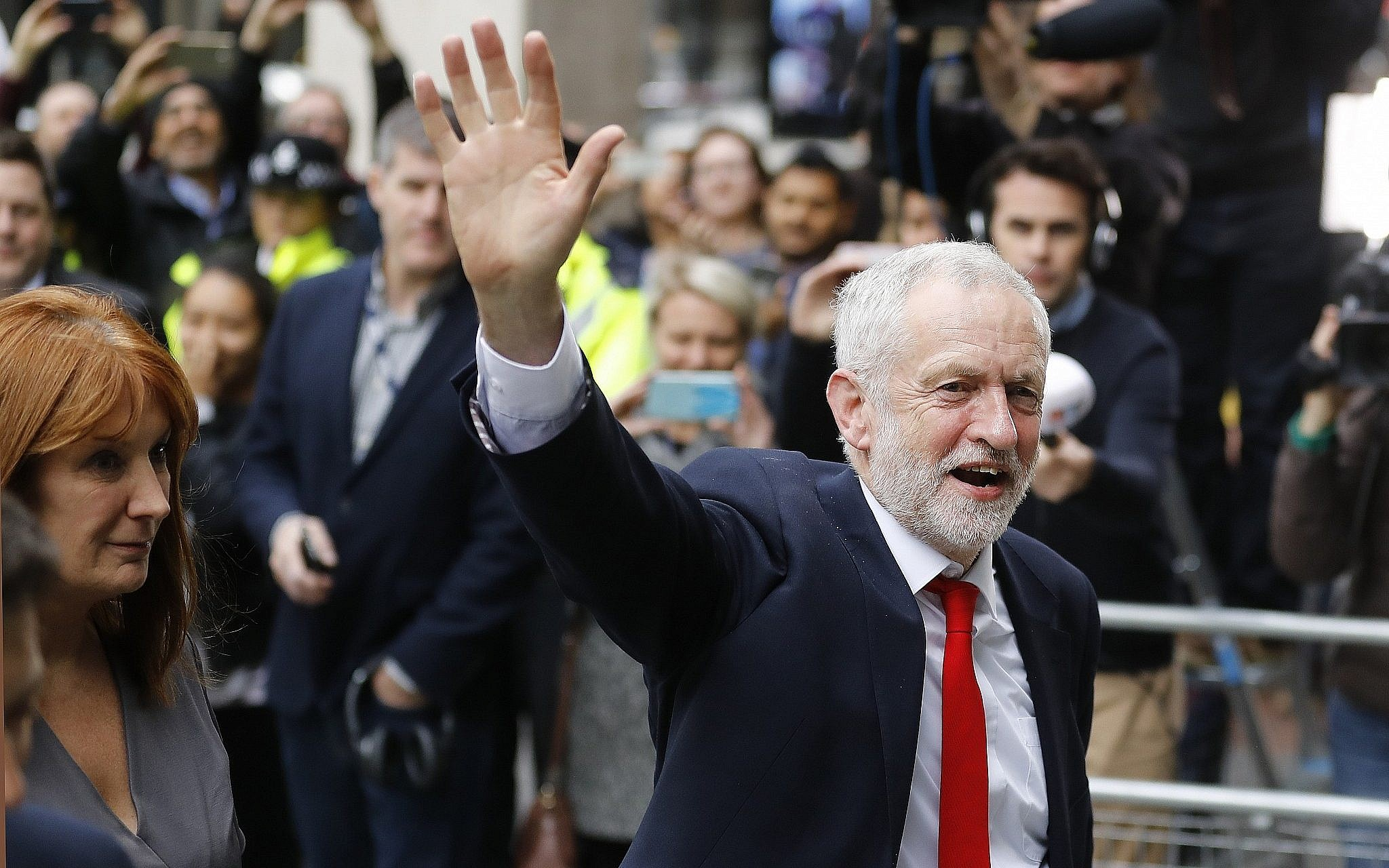Britain's Labour leader Jeremy Corbyn waves as he arrives at party headquarters in London, Friday, June 9, 2017, after the general elections (AP Photo/Frank Augstein)