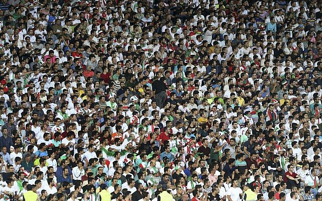 FILE -- Iranian soccer fans follow a qualifying match with Uzbekistan in their Asia Group A, 2018 Russia World Cup at the Azadi Stadium in Tehran, Iran, June 12, 2017 (AP Photo/Vahid Salemi)