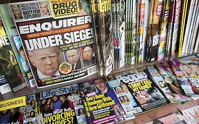 In this Wednesday, July 12, 2017 photo, an issue of the National Enquirer featuring President Donald Trump on it's cover is seen at a store in New York. (AP Photo/Mary Altaffer)