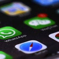 WhatsApp is seen with other mobile apps on a smartphone (AP Photo/Andy Wong)
