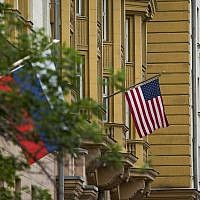 US and Russian flags hang at the U.S. Embassy in Moscow, Russia, Friday, July 28, 2017. (AP Photo/Alexander Zemlianichenko)