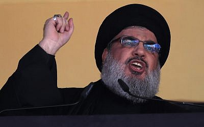 In this photo from October 24, 2015, Hezbollah leader Hassan Nasrallah addresses a crowd during the holy day of Ashoura, in a southern suburb of Beirut, Lebanon. (AP Photo/Hassan Ammar, File)