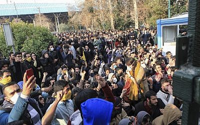 Illustrative image taken by an individual not employed by the Associated Press and obtained by the AP outside Iran, university students attend a protest inside Tehran University while anti-riot Iranian police prevent them to join other protestors, in Tehran, Iran, December 30, 2017. (AP Photo)