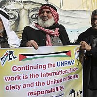 Refugees protest against the US for withholding $65 million from Palestinian aid programs, in front of the UNRWA offices in the Nusseirat refugee camp, central Gaza Strip, January 17, 2018.  (AP Photo/Adel Hana)