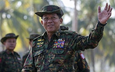 Myanmar military commander-in-chief Senior General Min Aung Hlaing gestures as he arrives to attend the second day of 'Sin Phyu Shin' joint military exercises, on February 3, 2018, in Ayeyarwaddy delta region, Myanmar. (Lynn Bo Bo/Pool Photo via AP)