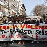 Demonstrators hold a banner reading 'Against Violence, Fascist, Racist, Sexist, Solidarity to the victims of Macerata' during an anti-racism demonstration following last Saturday's attacks in the Italian city of Macerata when six Africans were wounded in a two-hour drive-by shooting spree by a right-wing extremist, in Milan, Italy, February 10, 2018. (AP Photo/Antonio Calanni)