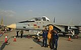 In this Sept. 23, 2015 file photo, Iranian soldiers take a picture with a Winnie the Pooh character next to a F-14 fighter jet in an exhibition of achievements and equipment of Iran's air force in Tehran, Iran. (AP/Ebrahim Noroozi)