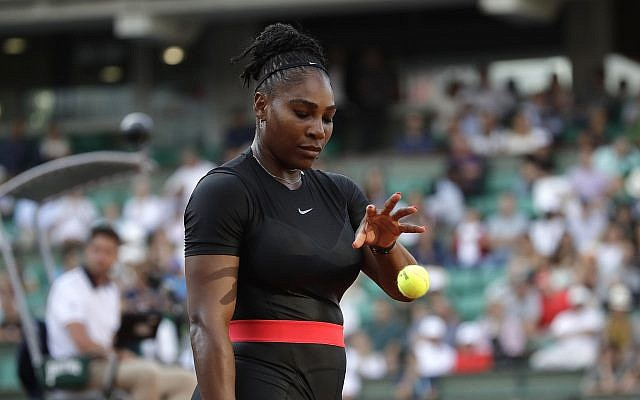 Serena Williams of the US catches a ball before serving to Australia's Ashleigh Barty during their second round match of the French Open tennis tournament at the Roland Garros stadium, May 31, 2018, in Paris. (AP Photo/ Alessandra Tarantino)
