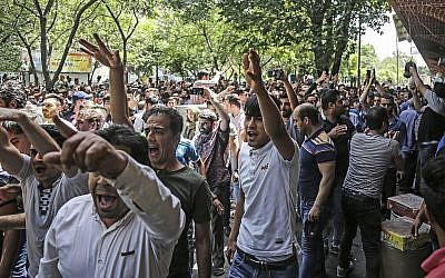 Illustrative: People protest the state of Iran's economy at the old grand bazaar in Tehran, Iran, Monday, June 25, 2018 (Iranian Labor News Agency via AP)