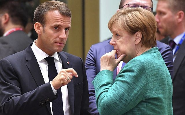 Illustrative: French President Emmanuel Macron, left, speaking with German Chancellor Angela Merkel during a round table meeting at an EU summit in Brussels, June 28, 2018. (AP Photo/Geert Vanden Wijngaert)