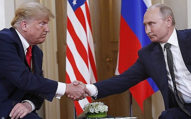 US President Donald Trump and Russian President Vladimir Putin shake hands at the beginning of a meeting at the Presidential Palace in Helsinki, Finland, Monday, July 16, 2018. (AP Photo/Pablo Martinez Monsivais)