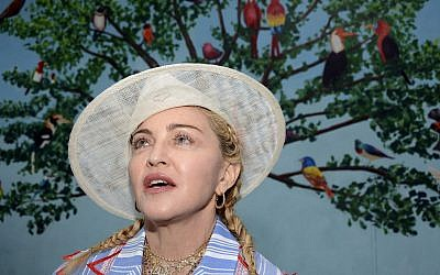 Madonna speaks to the press at a news conference in Blantyre, Malawi, July 16, 2018. (AP Photo/Thoko Chikondi)