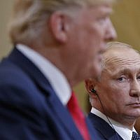 Russian President Vladimir Putin looks over toward US President Donald Trump, as Trump speaks during their joint news conference at the Presidential Palace in Helsinki, Finland, July 16, 2018. (AP Photo/Pablo Martinez Monsivais)