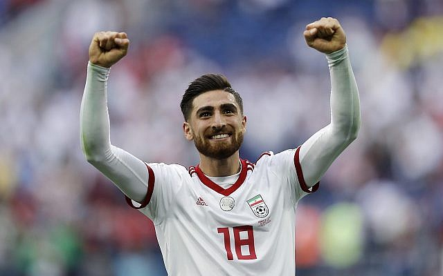 In this June 15, 2018 photo, Iran's Alireza Jahanbakhsh celebrates his team's victory after the group B match between Morocco and Iran at the 2018 soccer World Cup in the St. Petersburg Stadium in St. Petersburg, Russia. (AP Photo/Themba Hadebe)