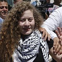 Ahed Tamimi waves after visiting the tomb of former Palestinian leader Yasser Arafat in the West Bank city of Ramallah, Sunday, July 29, 2018. (AP Photo/Majdi Mohammed)