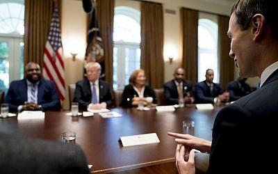 President Donald Trump's White House senior adviser Jared Kushner, right, attends a meeting along with President Donald Trump, second from left, with inner city pastors in the Cabinet Room of the White House in Washington, Wednesday, August 1, 2018. (AP/Andrew Harnik)