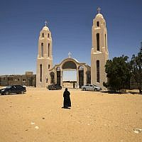 In this May 27, 2017 photo, a priest walks in front of St. Samuel the Confessor Monastery in Maghagha, Egypt. (AP Photo/Amr Nabil)