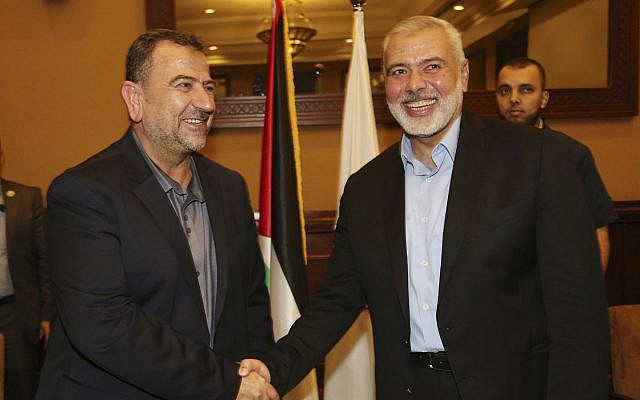 Ismail Haniyeh, right, the head of the Hamas political bureau, shakes hands with his deputy Saleh al-Arouri, upon his arrival in Gaza from Cairo, Egypt, in Gaza City, August 2, 2018. (Mohammad Austaz/Hamas Media Office via AP)