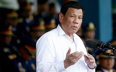 Philippine President Rodrigo Duterte gestures while addressing police force to mark the 117th Philippine National Police Service anniversary at Camp Crame in suburban Quezon city northeast of Manila, Philippines, on August 8, 2018. (AP Photo/Bullit Marquez)