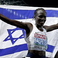Israel's Lonah Chemtai Salpeter celebrates winning the women's 10.000 meter final race at the European Athletics Championships in Berlin, Germany, Wednesday, Aug. 8, 2018. (AP Photo/Michael Sohn)