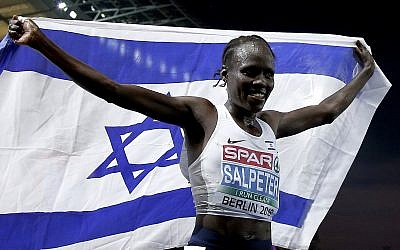 Israel's Lonah Chemtai Salpeter celebrates winning the women's 10,000 meter final race at the European Athletics Championships in Berlin, Germany, August 8, 2018. (AP Photo/Michael Sohn)