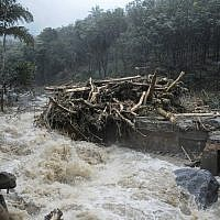 Water gushes out following heavy rain and landslide in Kozhikode, Kerala state, India, August 9, 2018. (AP Photo)