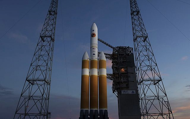 This photo provided by NASA shows the United Launch Alliance Delta IV Heavy rocket with the Parker Solar Probe onboard shortly after the Mobile Service Tower was rolled back Aug. 10, 2018, Launch Complex 37 at Cape Canaveral Air Force Station in Cape Canaveral, Florida (Bill Ingalls/NASA via AP)