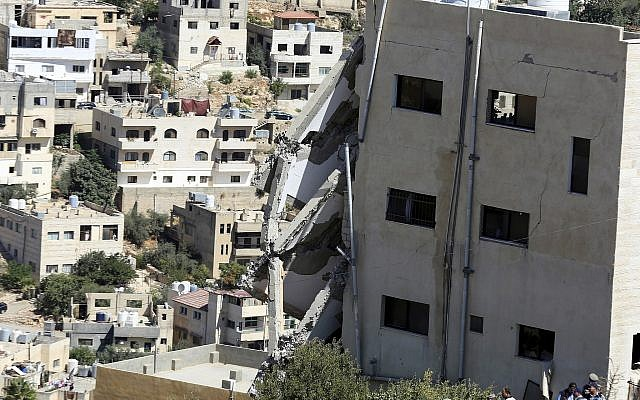 A wing of a building is seen collapsed in Salt, Jordan, Sunday, Aug. 12, 2018. Jordanian search teams pulled the bodies of three suspected terrorists from the rubble of their hideout, a government official said (AP Photo/Raad Adayleh)