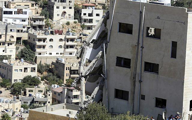 A wing of a building is seen collapsed in Salt, Jordan, August 12, 2018. (AP Photo/Raad Adayleh)