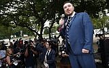 """White nationalist Jason Kessler speaks at a rally near the White House on the one-year anniversary of the Charlottesville """"Unite the Right"""" rally, Sunday, Aug. 12, 2018, in Washington. (AP Photo/Alex Brandon)"""