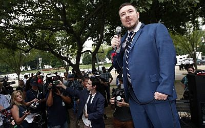 "White nationalist Jason Kessler speaks at a rally near the White House on the one-year anniversary of the Charlottesville ""Unite the Right"" rally, Sunday, Aug. 12, 2018, in Washington. (AP Photo/Alex Brandon)"