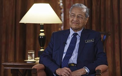 Malaysia Prime Minister Mahathir Mohamad listens during an interview with The Associated Press in Putrajaya, Malaysia, Monday, August 13, 2018. (Yam G-Jun/AP)