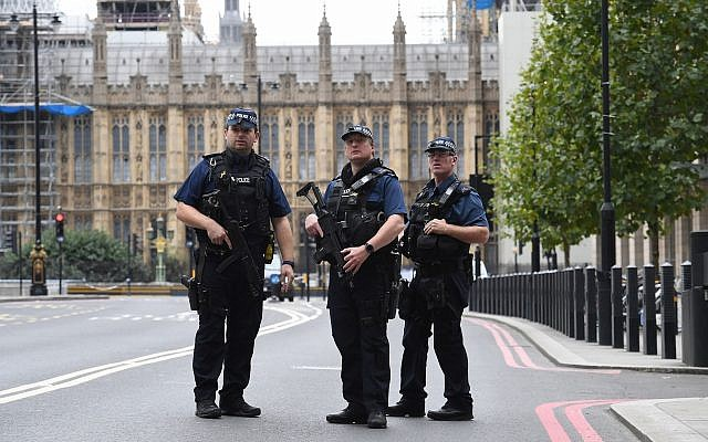 Illustrative: Armed police on Victoria Embankment in Westminster, after a car crashed into security barriers outside the Houses of Parliament, in London, August 14, 2018. (Stefan Rousseau/PA via AP)