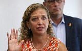Rep. Debbie Wasserman Schultz, D-Fla., gestures as she speaks against the dangers of 3D-printed guns, along with Fred Guttenberg, rear, during a news conference at the Sunrise Police Department, August 16, 2018, in Sunrise, Florida. (AP Photo/Wilfredo Lee)