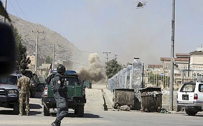 An MD 530F military helicopter targets a house where attackers are hiding in Kabul, Afghanistan, August 21, 2018. (AP Photo/Rahmat Gul)