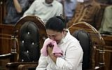 Ethnic Chinese woman Meiliana weeps during her sentencing hearing at a district court in Medan, North Sumatra, Indonesia, Tuesday, August 21, 2018. (AP/Binsar Bakkara)