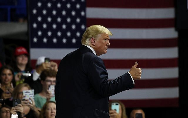 US President Donald Trump gives a thumbs up after speaking during a rally, August 21, 2018, in Charleston, West Virginia. (AP Photo/Alex Brandon)