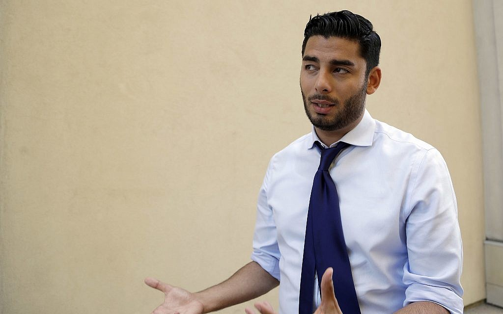 Democratic congressional candidate Ammar Campa-Najjar speaks during an interview Wednesday, Aug. 22, 2018, in San Diego (AP Photo/Gregory Bull)